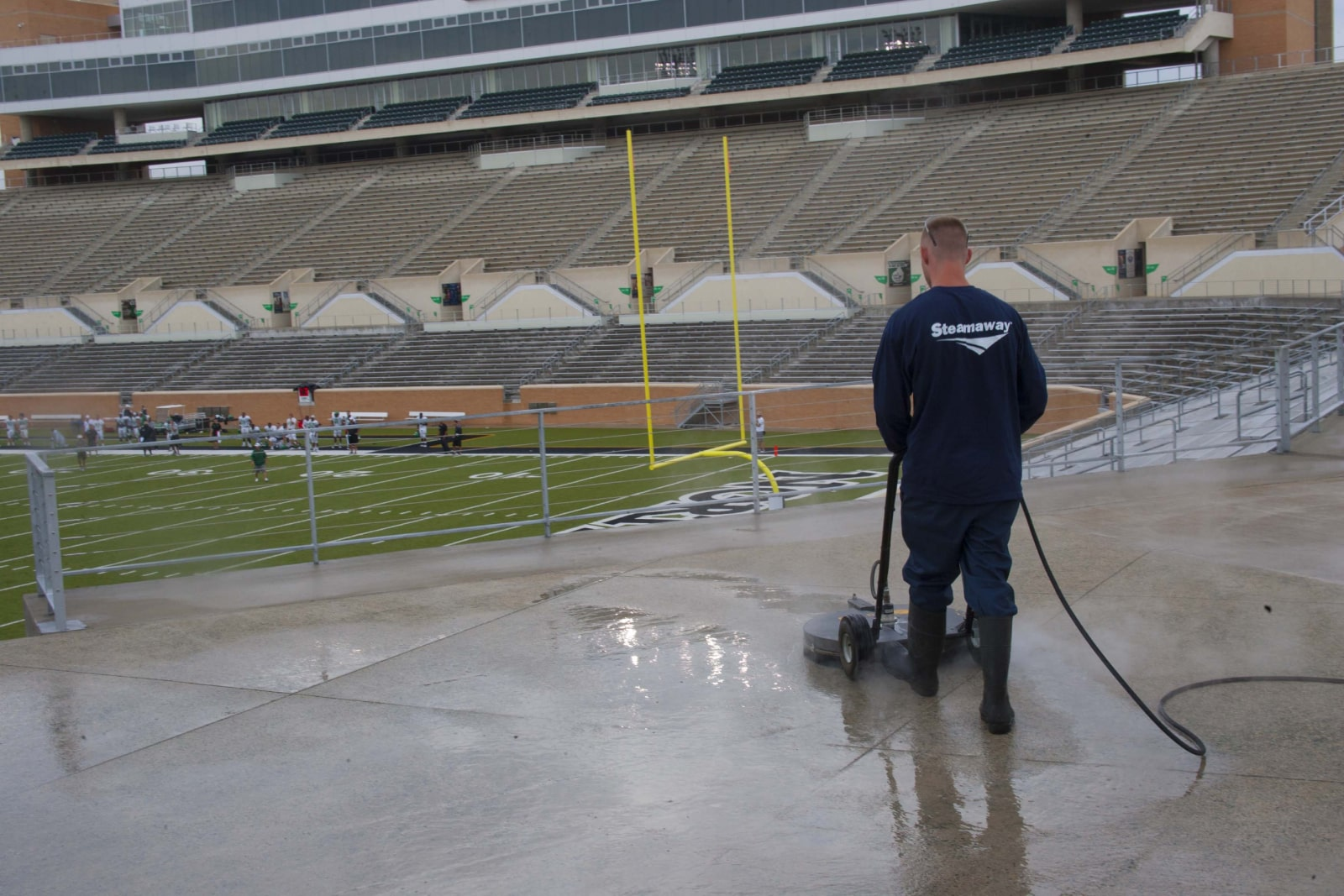 Commercial concrete cleaning of stadium floor